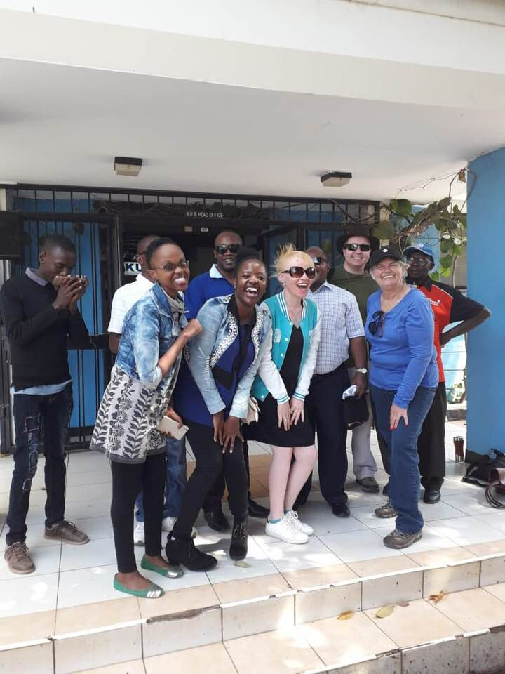 A group photo of the You Cane Give crew and Kenya Union of the Blind staff.